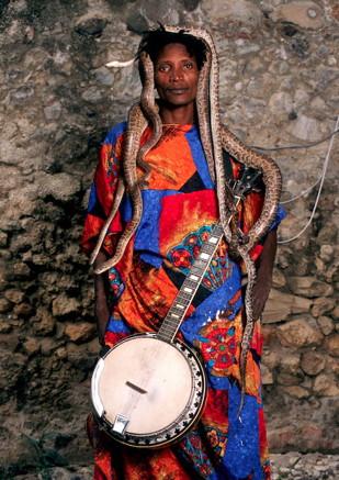 Man with banjo and snakes, Jacmel, Haiti, 2013